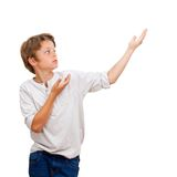 Young Boy pointing with hands at copy space. Stock Photo