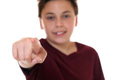 Young boy pointing with his finger I want you. Isolated on a white background Royalty Free Stock Photo