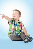 Young boy pointing at something Stock Photo