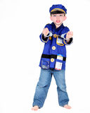 Young boy in police costume. With handcuffs on white background Stock Photos