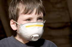 Young boy with pollution mask. Portrait of young boy with pollution mask Stock Photos