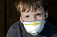 Young boy with pollution mask Royalty Free Stock Photography