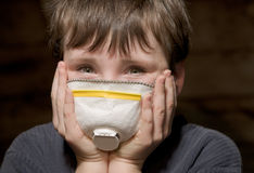 Young boy with pollution mask Stock Image