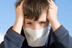 Young boy with pollution mask outdoor Stock Photo