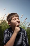 Young boy pondering Royalty Free Stock Photo