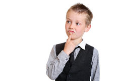Young Boy Pondering Stock Photo