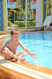 Young boy in the pool Stock Photo