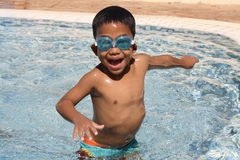Young boy at a pool Royalty Free Stock Photo