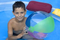 Young boy in pool Stock Photography