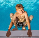 Young boy in the pool Stock Photos