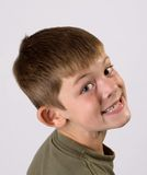 Young boy portrait big smile. Portrait of a young boy on an off-white background Royalty Free Stock Photos