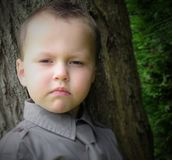 Young boy portrait. A young boy in a moody portrait Stock Photography