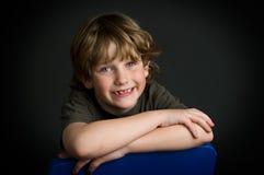 Young boy posing. Closeup of an adorable young boy posing in studio Stock Photos
