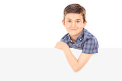 Young boy posing behind blank panel Stock Photo