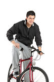 Young boy posing on a bike. A young boy posing on a bike isolated on white background royalty free stock image