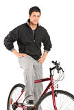 Young boy posing on a bike. A young boy posing on a bike isolated against white background stock photography