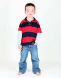 Young boy posing with hand in pocket. On white background Royalty Free Stock Photography