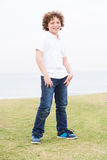 Young boy posing with hand in pocket Royalty Free Stock Photos