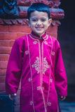 Young boy posing in traditional clothes in nepal Stock Photo