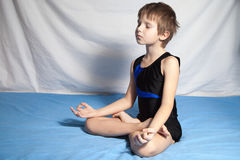 Young boy practices yoga royalty free stock photo