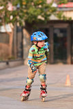 Young boy practicing inline skating, Beijing, China Royalty Free Stock Photos