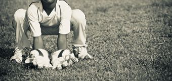 Young boy practicing wicket keeping around a field. A young kids doing wicket keeping practice around a cricket field unique photo royalty free stock images