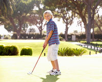 Young Boy Practising Golf stock image