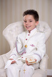 Young boy with prayer book and rosary in his First Holy Communio Royalty Free Stock Photo