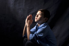 Young boy in prayer. Stock Photography