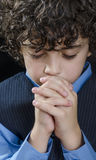 Young Boy Praying Stock Photography