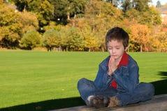 Young boy praying Royalty Free Stock Image