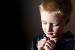 Young boy praying Stock Photos