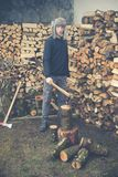 Young boy prepares firewood Royalty Free Stock Photos