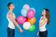 Young boy presenting baloons to a girl Stock Photography