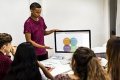 Young boy presenting a project to the team royalty free stock image