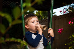 Young Boy With A Pretend Trumpet Royalty Free Stock Photos