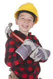 Young boy pretending to be a carpenter Stock Image