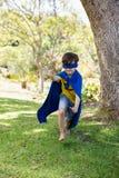 Young boy pretending to be a superhero Stock Photos