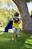 Young boy pretending to be a superhero Royalty Free Stock Photography