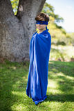 Young boy pretending to be a superhero Royalty Free Stock Image