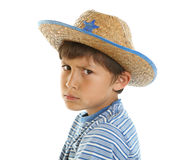 Young boy pretending to be tough. Young boy in cowboy hat pretending to be the tough guy - on isolated white background Stock Image