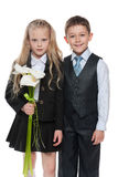 Young boy and pretty girl with flowers Royalty Free Stock Photos