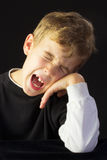 A Young Boy Protests Loudly Royalty Free Stock Images