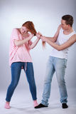 Young boy pulling girl's hair Royalty Free Stock Images