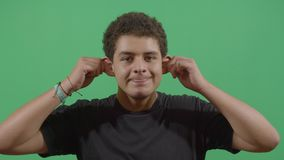 Young boy pulling his ears. In Ecuador stock footage