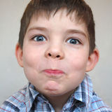 Young boy pulls a face royalty free stock photo