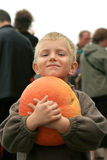Young boy with pumpkin. Royalty Free Stock Photos