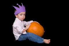 Young boy with a pumpkin Royalty Free Stock Image
