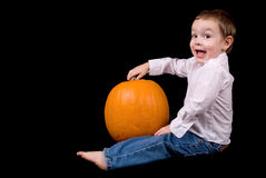 Young boy with a pumpkin stock photo
