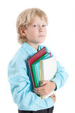 Young boy pupil embracing books with hands, looking at camera, isolated on white background Royalty Free Stock Photos